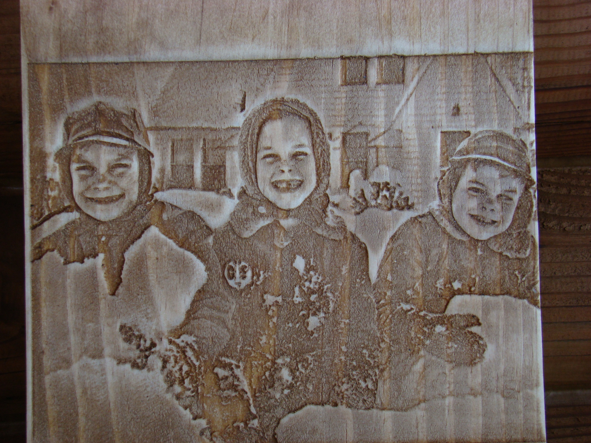 Wood carving of three children cir. 1956